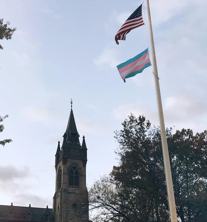 The trans flag raised up on Lehigh's flagpole in the center of campus