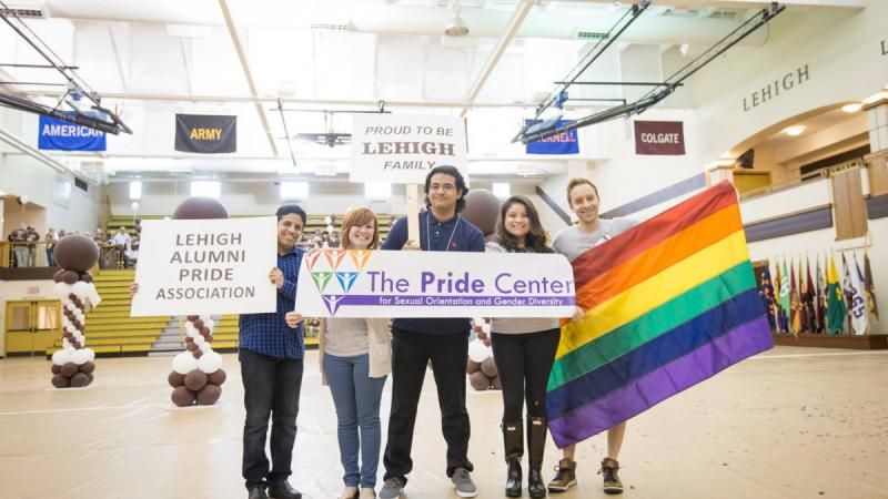 Members of Lehigh's Alumni Pride Association pose for a photograph