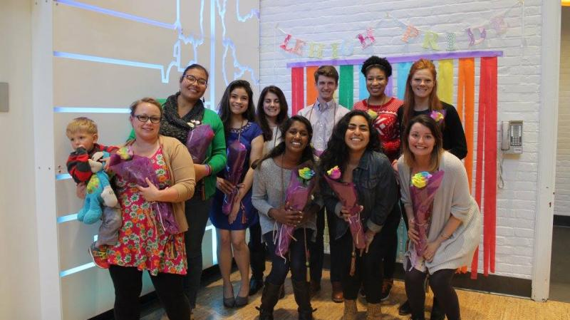 Recent graduates gather together in Williams Hall for the Take Pride Celebration