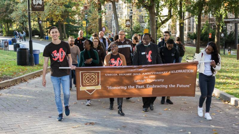Faculty, staff and students participate in the Umoja House Honor Walk