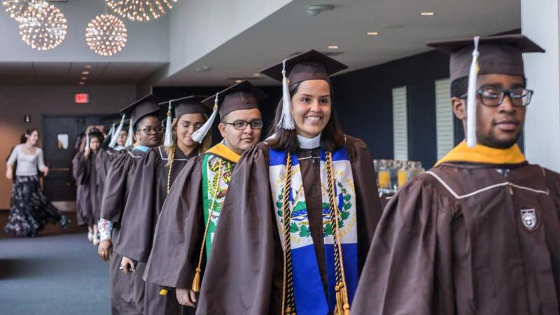 Graduates process into the Donning of the Kente Ceremony