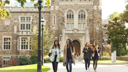 A group of women walk in front of Linderman Library